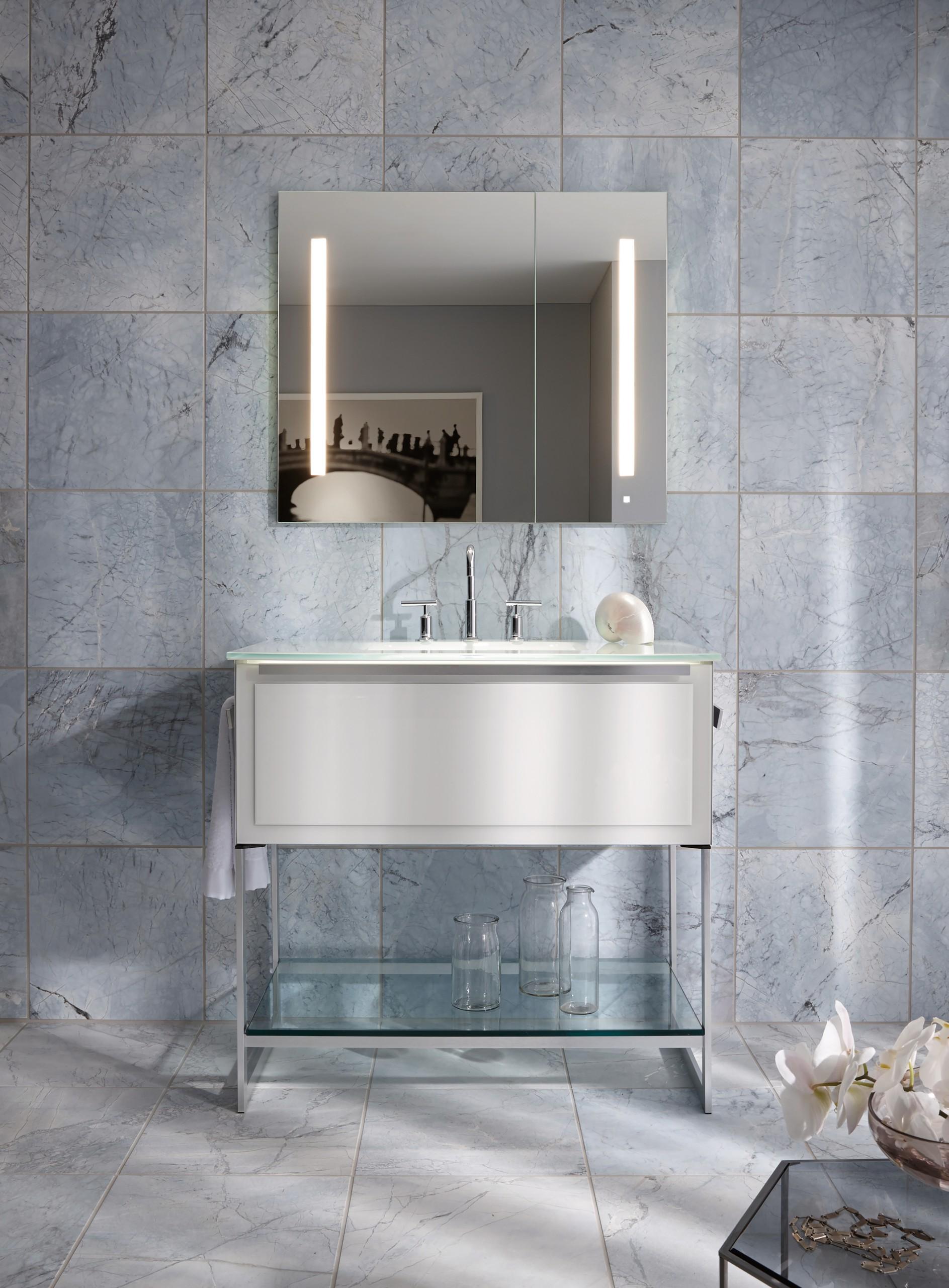 back-lit medicine cabinets in modern bathroom